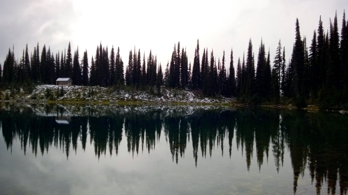 Reflections on Eva Lake at the top of Mount Revelstoke in British Columbia, Canada.